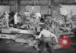 Image of Army artillery being repaired and reconditioned in a factory United States USA, 1945, second 11 stock footage video 65675076676