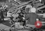 Image of Army artillery being repaired and reconditioned in a factory United States USA, 1945, second 12 stock footage video 65675076676