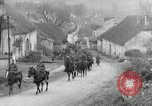 Image of AEF artillerymen moving through a French Village France, 1918, second 2 stock footage video 65675076714
