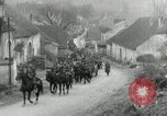 Image of AEF artillerymen moving through a French Village France, 1918, second 6 stock footage video 65675076714