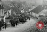 Image of AEF artillerymen moving through a French Village France, 1918, second 7 stock footage video 65675076714