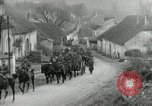 Image of AEF artillerymen moving through a French Village France, 1918, second 10 stock footage video 65675076714