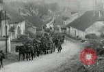 Image of AEF artillerymen moving through a French Village France, 1918, second 12 stock footage video 65675076714