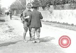 Image of US soldier teaches Asian man close order drill France, 1918, second 5 stock footage video 65675076719