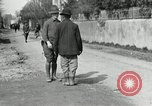 Image of US soldier teaches Asian man close order drill France, 1918, second 8 stock footage video 65675076719