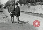 Image of US soldier teaches Asian man close order drill France, 1918, second 9 stock footage video 65675076719