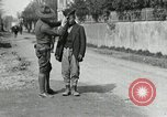Image of US soldier teaches Asian man close order drill France, 1918, second 12 stock footage video 65675076719