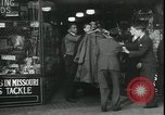 Image of Louis A Cumonow donating coats to needy Kansas City Missouri USA, 1935, second 2 stock footage video 65675076825