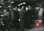 Image of Louis A Cumonow donating coats to needy Kansas City Missouri USA, 1935, second 4 stock footage video 65675076825