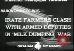 Image of Dairy farmers protest prices and dump milk Mukwonago Wisconsin USA, 1933, second 3 stock footage video 65675076834