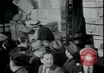 Image of unemployed receive apples during great depression New York City USA, 1930, second 2 stock footage video 65675076853