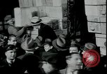 Image of unemployed receive apples during great depression New York City USA, 1930, second 3 stock footage video 65675076853