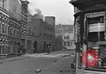 Image of Burning armored vehicle in city Nijmegen Netherlands, 1944, second 9 stock footage video 65675076969