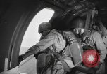 Image of US parachute infantry make practice drop in World War 2 England, 1944, second 1 stock footage video 65675077002