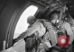 Image of US parachute infantry make practice drop in World War 2 England, 1944, second 2 stock footage video 65675077002