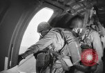 Image of US parachute infantry make practice drop in World War 2 England, 1944, second 4 stock footage video 65675077002