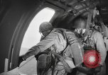 Image of US parachute infantry make practice drop in World War 2 England, 1944, second 5 stock footage video 65675077002