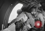 Image of US parachute infantry make practice drop in World War 2 England, 1944, second 6 stock footage video 65675077002