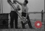 Image of First liquid fuel rocket is launched from Staten Island in New York Staten Island New York USA, 1933, second 8 stock footage video 65675077065