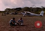Image of UH-1 Iroquois helicopter extricate combat team United States USA, 1970, second 4 stock footage video 65675077321