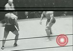 Image of boxing bout New York City USA, 1930, second 9 stock footage video 65675077340