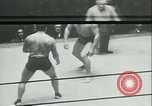 Image of boxing bout New York City USA, 1930, second 10 stock footage video 65675077340
