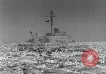 Image of USS Burton Island breaking way through ice in Bering Sea Bering Sea, 1952, second 1 stock footage video 65675077436