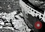 Image of USS Burton Island breaking way through ice in Bering Sea Bering Sea, 1952, second 7 stock footage video 65675077436