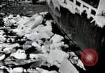 Image of USS Burton Island breaking way through ice in Bering Sea Bering Sea, 1952, second 11 stock footage video 65675077436