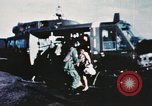 Image of wounded children airlifted via helicopter Vietnam, 1966, second 1 stock footage video 65675077439
