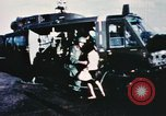 Image of wounded children airlifted via helicopter Vietnam, 1966, second 2 stock footage video 65675077439