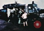 Image of wounded children airlifted via helicopter Vietnam, 1966, second 3 stock footage video 65675077439