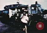 Image of wounded children airlifted via helicopter Vietnam, 1966, second 5 stock footage video 65675077439