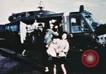 Image of wounded children airlifted via helicopter Vietnam, 1966, second 6 stock footage video 65675077439