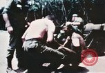 Image of medical aid via Huey helicopter and ambulance Vietnam, 1966, second 1 stock footage video 65675077440