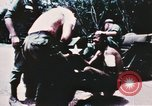 Image of medical aid via Huey helicopter and ambulance Vietnam, 1966, second 2 stock footage video 65675077440