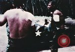 Image of medical aid via Huey helicopter and ambulance Vietnam, 1966, second 5 stock footage video 65675077440