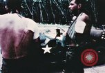 Image of medical aid via Huey helicopter and ambulance Vietnam, 1966, second 6 stock footage video 65675077440