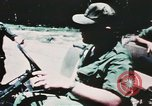 Image of medical aid via Huey helicopter and ambulance Vietnam, 1966, second 7 stock footage video 65675077440