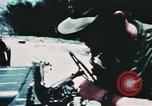 Image of medical aid via Huey helicopter and ambulance Vietnam, 1966, second 8 stock footage video 65675077440