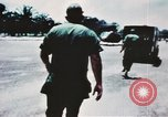 Image of medical aid via Huey helicopter and ambulance Vietnam, 1966, second 12 stock footage video 65675077440