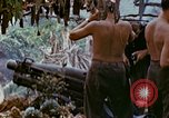 Image of wounded Marines Saipan Northern Mariana Islands, 1945, second 7 stock footage video 65675077538