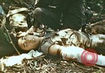Image of wounded Marines Saipan Northern Mariana Islands, 1945, second 9 stock footage video 65675077538