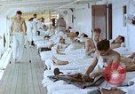 Image of wounded Marines Pacific Ocean, 1945, second 1 stock footage video 65675077542