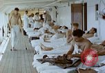 Image of wounded Marines Pacific Ocean, 1945, second 3 stock footage video 65675077542