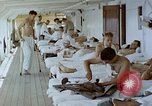 Image of wounded Marines Pacific Ocean, 1945, second 5 stock footage video 65675077542