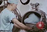 Image of wounded Marines Pacific Ocean, 1945, second 9 stock footage video 65675077542