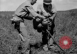 Image of flame thrower Solomon Islands, 1945, second 7 stock footage video 65675077699