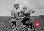 Image of flame thrower Solomon Islands, 1945, second 10 stock footage video 65675077699