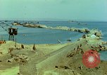 Image of bombed breakwater Italy, 1944, second 3 stock footage video 65675078061